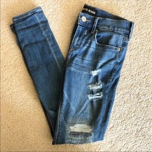 Express mid rise skinny destroyed jeans size 2R
